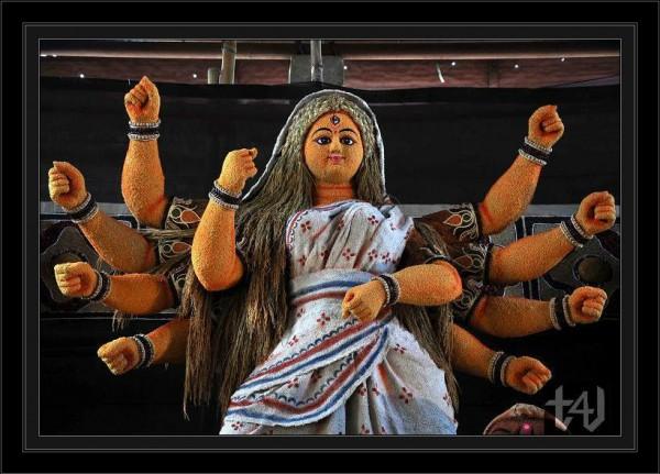 Idol maker busy in making goddes durga using food grains (2)